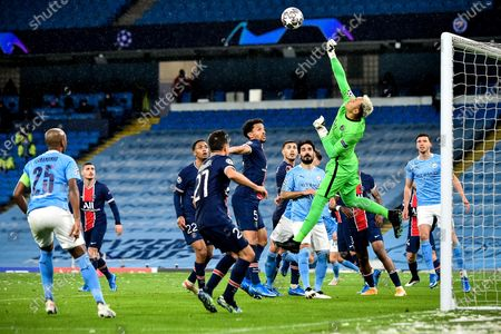 Stock Photo of PSG's goalkeeper Keylor Navas (2-R) in action during the UEFA Champions League semi final, second leg soccer match between Manchester City and Paris Saint-Germain in Manchester, Britain, 04 May 2021.