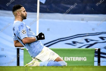 Stock Photo of Manchester City's Riyad Mahrez celebrates after scoring the 2-0 goal during the UEFA Champions League semi final, second leg soccer match between Manchester City and Paris Saint-Germain in Manchester, Britain, 04 May 2021.