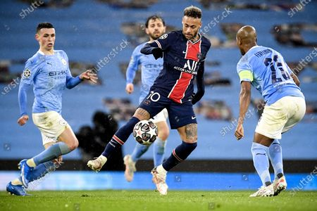 PSG's Neymar (C) in action against Manchester City's Fernandinho (R) and Phil Foden (L) during the UEFA Champions League semi final, second leg soccer match between Manchester City and Paris Saint-Germain in Manchester, Britain, 04 May 2021.