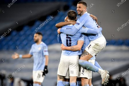 Manchester City's Kyle Walker (R) and his teammates celebrate after winning the UEFA Champions League semi final, second leg soccer match between Manchester City and Paris Saint-Germain in Manchester, Britain, 04 May 2021.