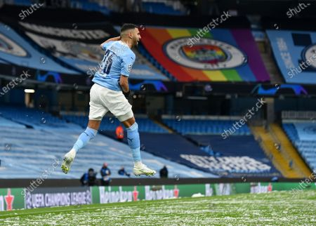 Stock Image of Manchester City's Riyad Mahrez celebrates after scoring the first goal during the UEFA Champions League semi final, second leg soccer match between Manchester City and Paris Saint-Germain in Manchester, Britain, 04 May 2021.