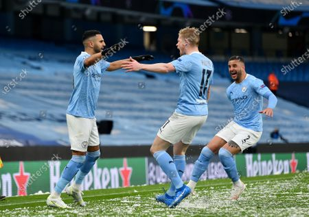 Manchester City's Riyad Mahrez celebrates after scoring the first goal during the UEFA Champions League semi final, second leg soccer match between Manchester City and Paris Saint-Germain in Manchester, Britain, 04 May 2021.