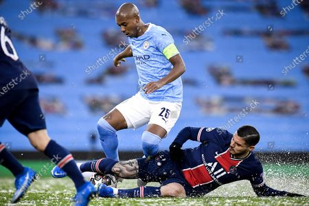 Manchester City's Fernandinho (L) in action against PSG's Leandro Paredes (R) during the UEFA Champions League semi final, second leg soccer match between Manchester City and Paris Saint-Germain in Manchester, Britain, 04 May 2021.