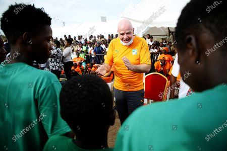 The president of the International Federation of Association Football (FIFA) Gianni Infantino (C) talks to young soccer players during the launch of the Pan-African interschool championship in Abidjan, Ivory Coast, 04 May 2021. FIFA President Infantino is in Abidjan for a working visit.
