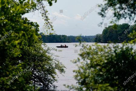 Stock Image of Anglers fish off a boat at the Loch Raven Reservoir, in Glen Arm, Md