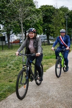 """Stock Picture of Roxana Maracineanu, Minister of Sports, participates in the """"Savoir Rouler a Velo"""" training of the Nelson Mandela primary school of Poissy in the Yvelines with Karl Olive, Mayor of Poissy"""