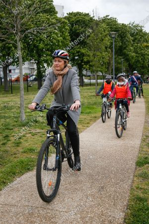 """Barbara Pompili, Minister of Ecological Transition and Roxana Maracineanu, Minister of Sports, participate in the """"Savoir Rouler a Velo"""" training of Nelson Mandela de Poissy primary school in the Yvelines in the presence of Karl Olive, Mayor of Poissy"""