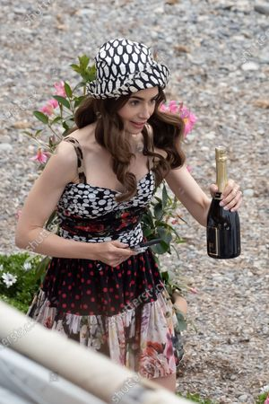 Actress Lily Collins is seen filming on set of season two of 'Emily in Paris'