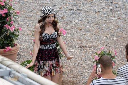Stock Photo of Actress Lily Collins is seen filming on set of season two of 'Emily in Paris'