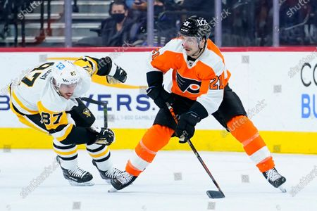 Philadelphia Flyers' Scott Laughton, right, tries to keep away from Pittsburgh Penguins' Sidney Crosby during the first period of an NHL hockey game, in Philadelphia