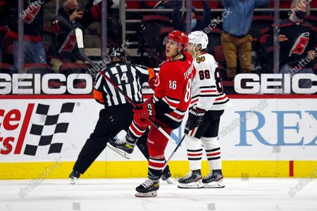 Carolina Hurricanes' Teuvo Teravainen (86) celebrates his goal as Chicago Blackhawks' Patrick Kane (88) skates by during the third period of an NHL hockey game in Raleigh, N.C