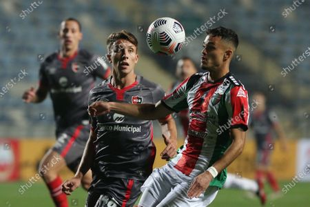 Vicente Fernandez (R) of Palestino vies for the ball with Milton Leyendeker of Newell's during the Copa Sudamericana soccer match between Palestino and Newell's at El Teniente stadium in Rancagua, Chile, 04 May 2021.