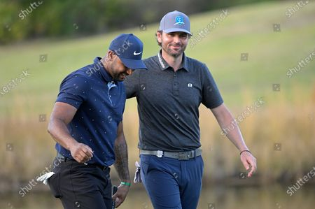Professional baseball player Aaron Hicks and former professional tennis player Mardy Fish share a laugh while walking on the 18th fairway during the final round of the Tournament of Champions LPGA golf tournament, in Lake Buena Vista, Fla