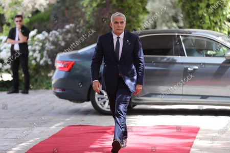 Stock Image of The Leader of the Yesh Atid party, Yair Lapid, enters the residence of President Reuven Rivlin, in Jerusalem, Israel, 05 May 2021. Israeli Prime Minister Benjamin Netanyahu failed to form a government with at least 61 Knesset seats as the deadline issued by the President has ended. The mandate to form a government is expected to pass to the Yesh Atid party.