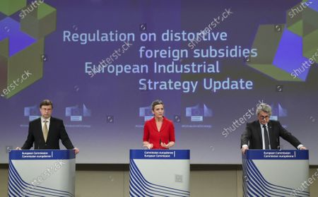 European Commission Vice Presidents Margrethe Vestager, center, Valdis Dombrovskis, left, and EU Commissioner for Internal Market Thierry Breton participate in a media conference on the proposal for a Regulation to address distortions caused by foreign subsidies in the Single Market and on the European Industrial Strategy Update at EU headquarters in Brussels