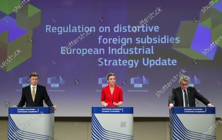 European Commission Vice Presidents Margrethe Vestager (C) and Valdis Dombrovskis (L), and EU Commissioner for Internal Market Thierry Breton (R) hold a news conference in Brussels, Belgium, 05 May 2021. The Commissioners gave an update on the European Industrial Strategy and the EU's twin transition to a green and digital economy.