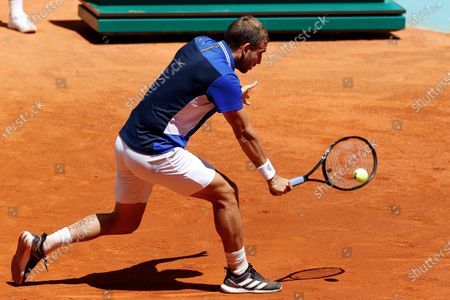 Daniel Evans of Britain in action against John Millman of Australia during their Mutua Madrid Open round of 32 match in Madrid, Spain, 05 May 2021.
