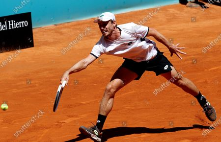 John Millman of Australia in action against Daniel Evans of Britain during their Mutua Madrid Open round of 32 match in Madrid, Spain, 05 May 2021.