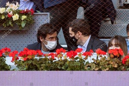 Stock Photo of Former Spanish soccer player Raul Gonzalez (L) and goalkeeper Iker Kasillas (R) chat during a match between Rafa Nadal of Spain and Carlos Alcaraz of Spain at the Mutua Madrid Open tennis tournament in Madrid, Spain, 05 May 2021.