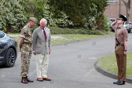 Prince Charles is received by Commanding Officer, Lieutenant Colonel Henry Llewelyn-Usher as he arrives to visit members of the Welsh Guards at Combermere Barracks