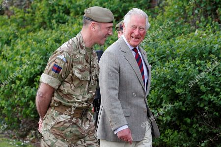Prince Charles walks with Commanding Officer, Lieutenant Colonel Henry Llewelyn-Usher as he arrives to visit members of the Welsh Guards at Combermere Barracks