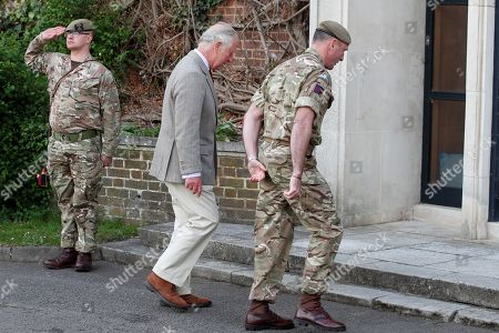 Prince Charles walks with Commanding Officer, Lieutenant Colonel Henry Llewelyn-Usher to the Officers' Mess as he arrives to visit members of the Welsh Guards at Combermere Barracks