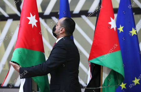 A member of Jordan's protocol adjusts the national flag ahead of Jordan's King Abdullah II ibn Al Hussein visit at the European Council in Brussels, Belgium, 05 May 2021.