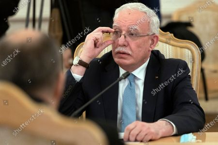 Palestinian Foreign Minister Riyad Al-Maliki listens to Russian Foreign Minister Sergey Lavrov during their talks in Moscow, Russia