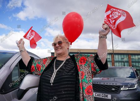 Scottish Labour fans at an outdoor rally for Scottish Labour in Glasgow on the eve of polling day.