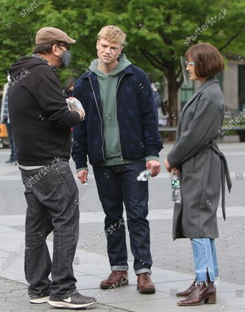 Chris Long director, Tom Rhys Harries, Elizabeth Henstridge on the set of the new Apple TV series Suspicion at Washington Square Park