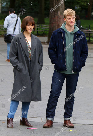 Elizabeth Henstridge, Tom Rhys Harries on the set of the new Apple TV series Suspicion at Washington Square Park
