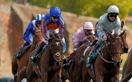DUBAI FOUNTAIN (right, Franny Norton) with LA JOCONDE (left, Oisin Murphy) on her way to winning The Weatherbys ePassport Cheshire Oaks beneath the city walls Chester