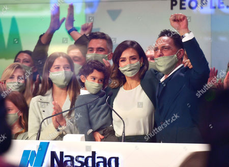 Jessica Alba rings the opening bell at the NASDAQ site in New York. With Honor Marie and Hayes Alba Warren