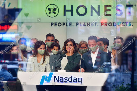 Stock Photo of Jessica Alba rings the opening bell at the NASDAQ site in New York. With Honor Marie, Cash Warren and Hayes Alba Warren