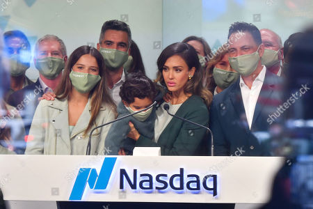 Jessica Alba rings the opening bell at the NASDAQ site in New York. With Honor Marie, Cash Warren and Hayes Alba Warren
