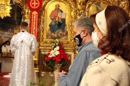 Former President of Ukraine Petro Poroshenko and his wife Maryna Poroshenko attend the Easter service at St Michael's Golden-Domed Cathedral, Kyiv, capital of Ukraine.