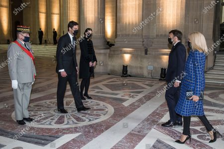 Prince Jean-Christophe Napoleon, second left, and his wife Princess Olympia von und zu Arco-Zinneberg, third left, welcome French President Emmanuel Macron and his wife Brigitte Macron, right, prior to a ceremony to commemorate the 200th anniversary of Napoleon Bonaparte's death, under the dome of the Saint-Louis cathedral at the Invalides monument in Paris, . French President Emmanuel Macron is leading commemorations of the bicentenary of the death of Napoleon Bonaparte on May 5, 1821 on the remote island of St. Helena, amid debate over the French emperor's legacy and role in reinstating slavery in French colonies