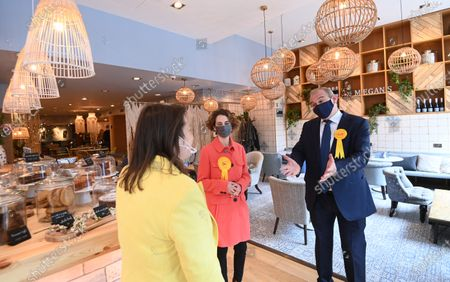 Liberal Democrat leader Sir Ed Davey (R) and the party's London mayoral candidate Luisa Porritt (C) campaign during a visit to Surbiton in south-west London, Britain, 05 May 2021.  The 2021 London mayoral election will be held on 06 May 2021.