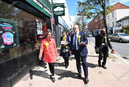 Liberal Democrat leader Sir Ed Davey (2-R) and the party's London mayoral candidate Luisa Porritt (L) campaign during a visit to Surbiton in south-west London, Britain, 05 May 2021.  The 2021 London mayoral election will be held on 06 May 2021.
