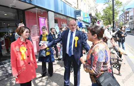 Stock Picture of Liberal Democrat leader Sir Ed Davey (C) and the party's London mayoral candidate Luisa Porritt (L) campaign during a visit to Surbiton in south-west London, Britain, 05 May 2021.  The 2021 London mayoral election will be held on 06 May 2021.