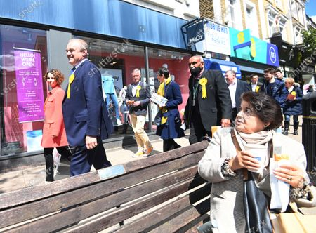 Stock Image of Liberal Democrat leader Sir Ed Davey (2-L) and the party's London mayoral candidate Luisa Porritt (L) campaign during a visit to Surbiton in south-west London, Britain, 05 May 2021.  The 2021 London mayoral election will be held on 06 May 2021.