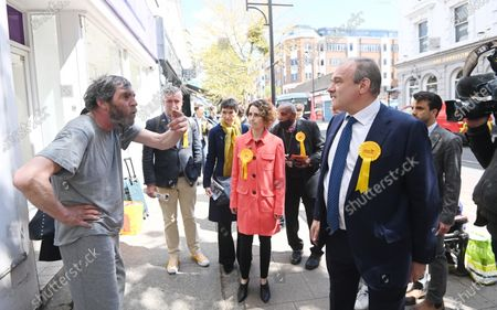 Stock Photo of Liberal Democrat leader Sir Ed Davey (R) and the party's London mayoral candidate Luisa Porritt (2-R) campaign during a visit to Surbiton in south-west London, Britain, 05 May 2021.  The 2021 London mayoral election will be held on 06 May 2021.