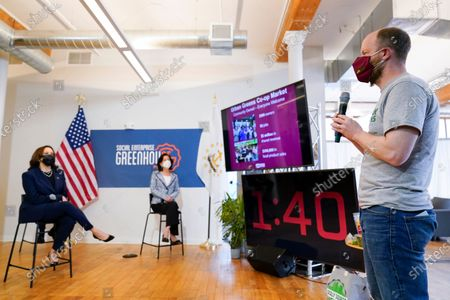 Philip Trevvett, founder of Urban Greens, right, speaks during a meeting with Vice President Kamala Harris and Secretary of Commerce Secretary Gina Raimondo at the Social Enterprise Greenhouse, in Providence, R.I