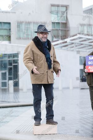 Alliance founder George Galloway (L) makes a speech outside the Scottish Parliament, the day before the country goes to the polls, in Edinburgh, Scotland, Britain, 05 May 2021.