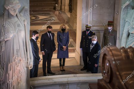 French President Emmanuel Macron (2L), his wife Brigitte Macron (C) stand in front of Napoleon's tomb next to Prince Jean-Christophe Napoleon (L) during a ceremony to commemorate the bicentenary of French Emperor's death under the dome of the Saint-Louis cathedral in the Invalides National Hotel in Paris, France, 05 May 2021. 200 years ago, French military and political leader Napoleon Bonaparte (1769-1821) died in exile on the island of Saint Helena on 05 May 1821. Official commemorations of the bicentenary of his death spark controversy in France among those who consider him to represent a dark part of the country's history and those who support his legacy.