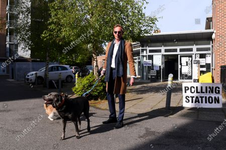 Laurence Fox casts his vote at a polling station in Vauxhall, London, accompanied by his dogs Blaze, Sparky and Mrs Thatcher.