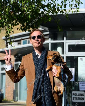 Laurence Fox casts his vote at a polling station in Vauxhall, London, accompanied by his dog Mrs Thatcher.