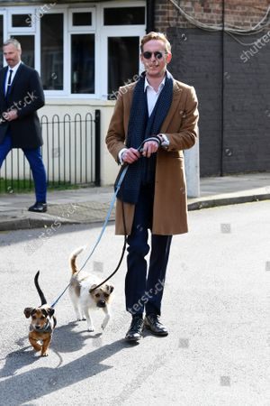 Stock Image of Laurence Fox casts his vote at a polling station in Vauxhall, London, accompanied by his dogs Sparky and Mrs Thatcher.