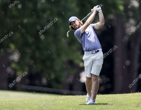 Stock Picture of Tommy Fleetwood of England hits from the rough by the ninth fairway during the Wells Fargo Championship Pro-Am at Quail Hollow Club in Charlotte, North Carolina, USA, 05 May 2021. The Wells Fargo Championship will be played 06 May through 10 May.