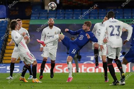 Chelsea's Timo Werner, center, kicks the ball during the Champions League semifinal 2nd leg soccer match between Chelsea and Real Madrid at Stamford Bridge in London